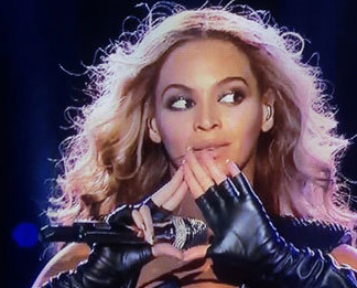 Beyonce doing the pyramid symbol.